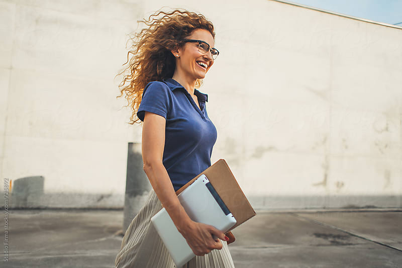 Businesswoman walking. by Studio Firma for Stocksy United