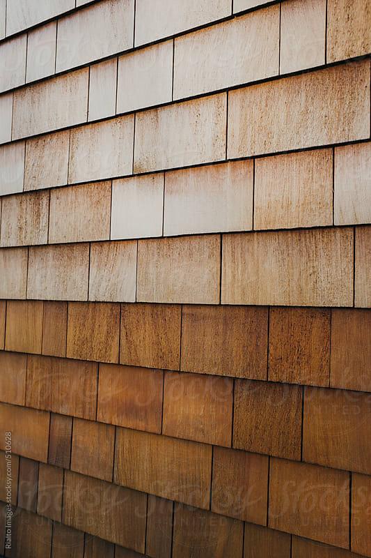 Cedar shingles on building wall exterior by Paul Edmondson for Stocksy United
