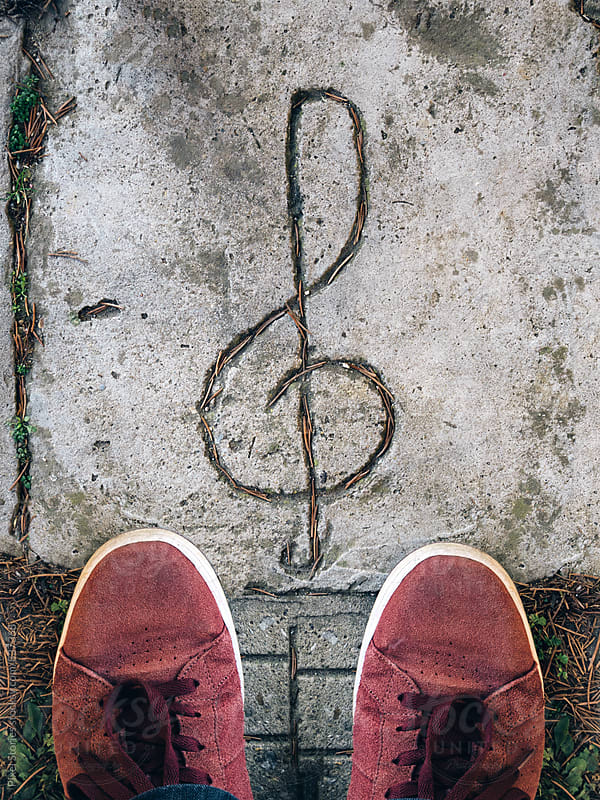 Standing in front of clef symbol by Pixel Stories for Stocksy United