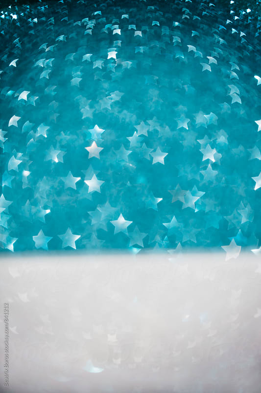 Minimal concept of snowy landscape and starry sky made with star shaped bokeh by Beatrix Boros for Stocksy United