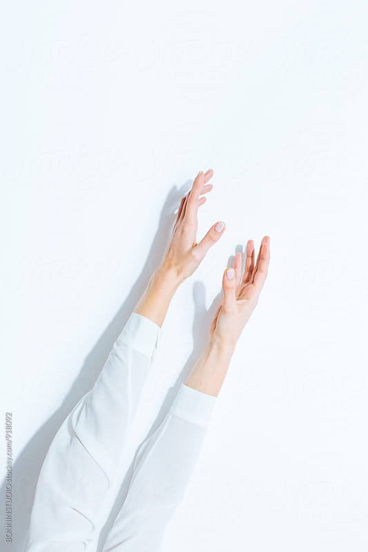 Female's hand over white background. by BONNINSTUDIO for Stocksy United