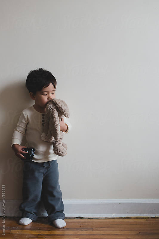 Little boy kissing stuffed animal by Lauren Naefe for Stocksy United