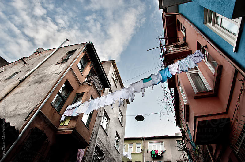 Clothes hanging between two buildings in the neighborhood of Balat and fenet in istanbul by Jean-Claude Manfredi for Stocksy United