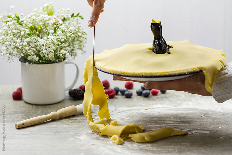 Cutting pie crust by Kirsty Begg for Stocksy United