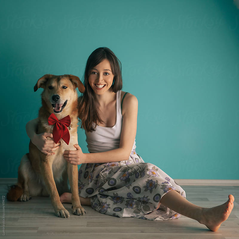Smiling Woman and Her Dog by Lumina for Stocksy United