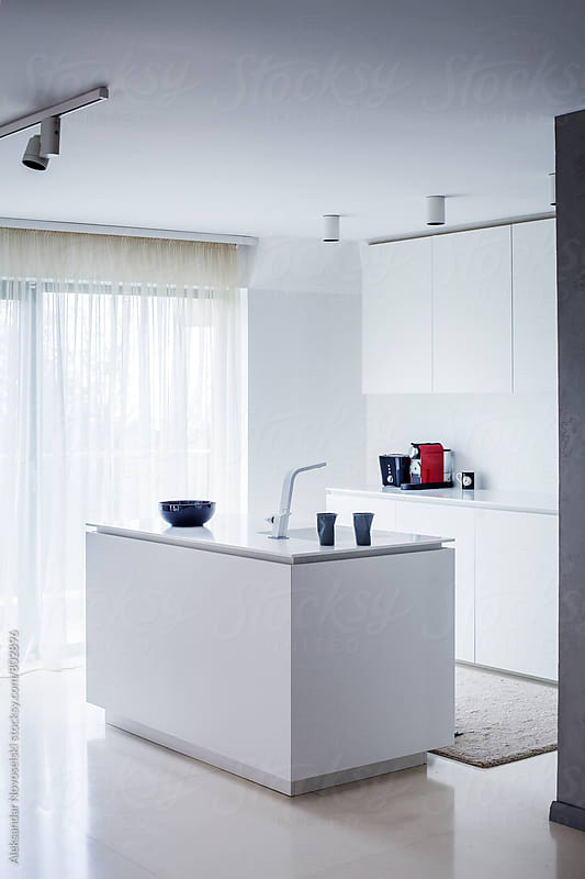 Minimalist white kitchen in contemporary interior by Aleksandar Novoselski for Stocksy United