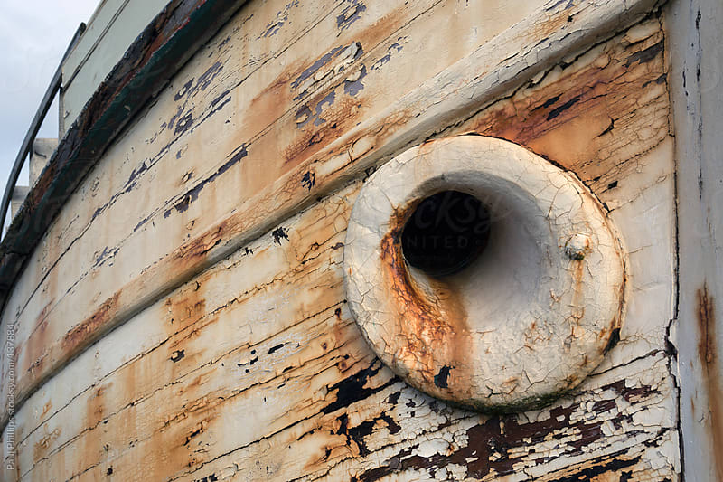 Corroded bow of an old fishing boat showing anchor hole by Paul Phillips for Stocksy United