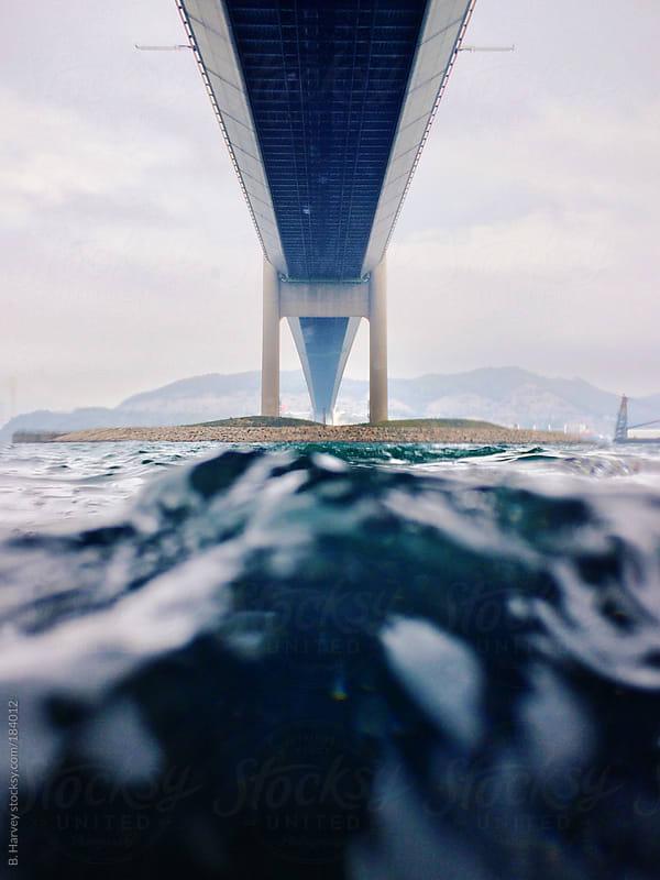 Underwater Shot Beneath a Bridge by B. Harvey for Stocksy United