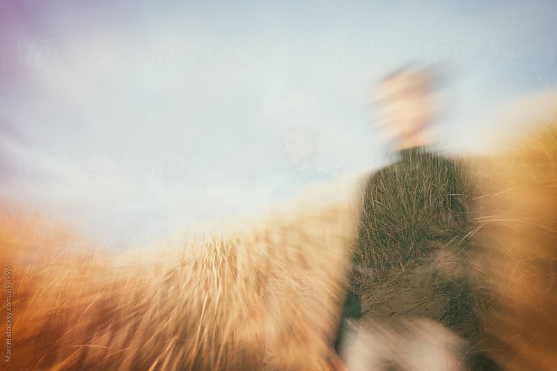 Double exposure portrait of girl in the dunes by Marcel for Stocksy United