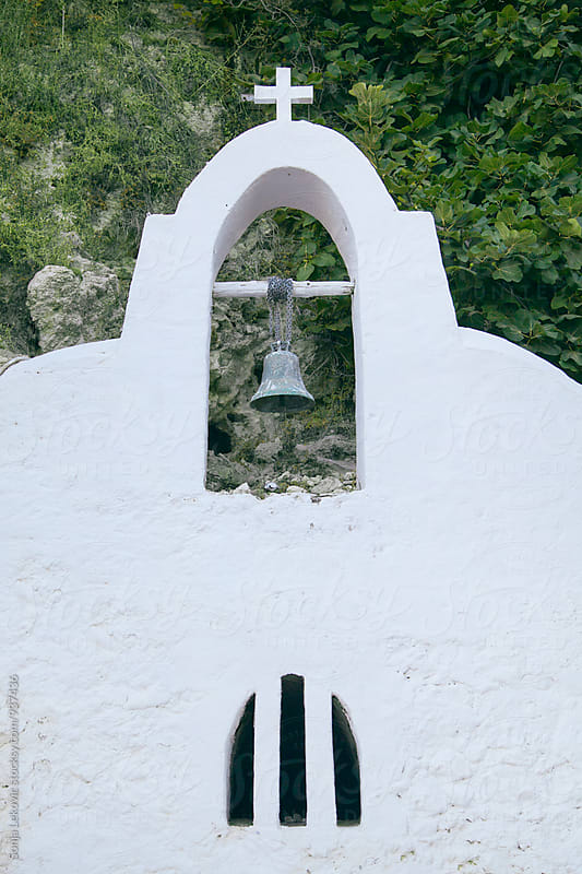 white church bell and cross by Sonja Lekovic for Stocksy United