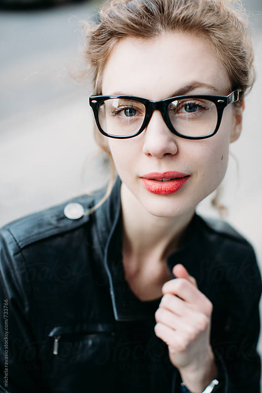 Portrait of attractive woman with glasses by michela ravasio for Stocksy United