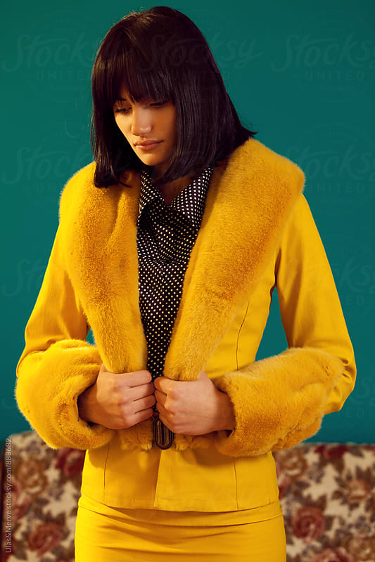 portrait of beautiful woman wearing yellow jacket by Ulaş and Merve for Stocksy United
