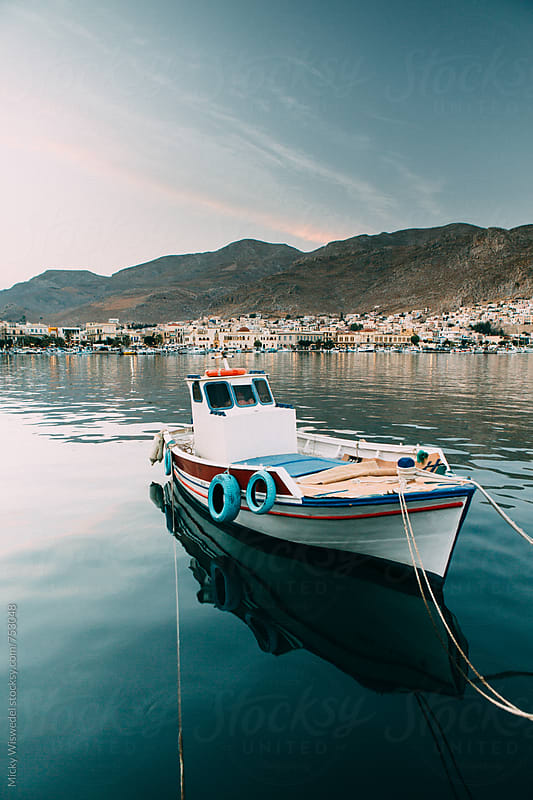 A small fishing boat in a harbour in Kalymnos, Greece by Micky Wiswedel for Stocksy United