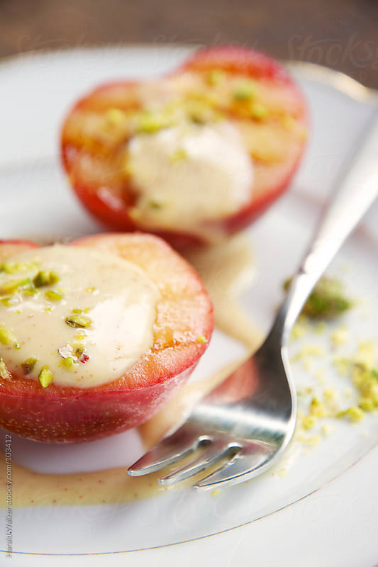 Grilled Plums with Maple Cinnamon Soy Yogurt and Pistachios by Harald Walker for Stocksy United