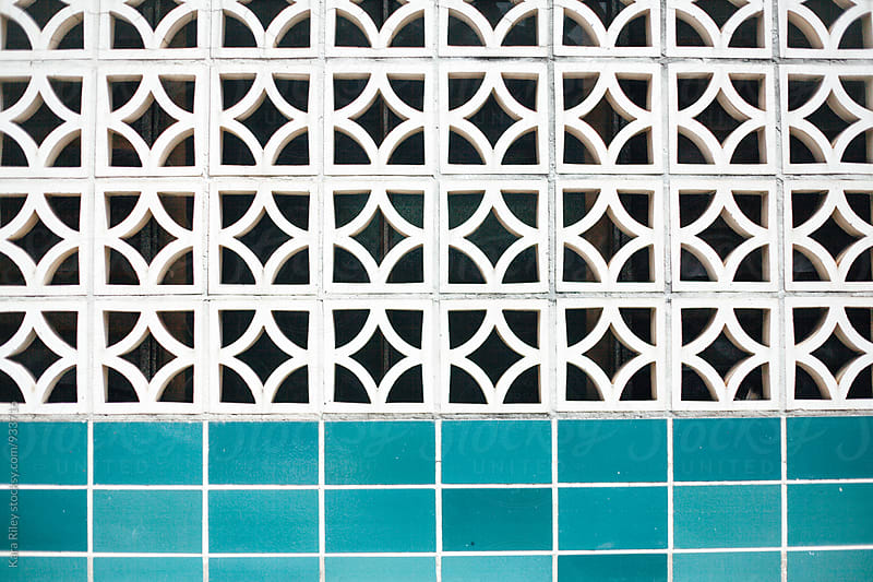 Breezeblocks wall and blue tiles by Kara Riley for Stocksy United