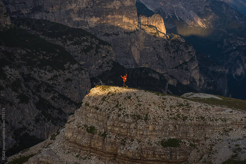 Happy Male hiker running to the top of the mountain by RG&B Images for Stocksy United