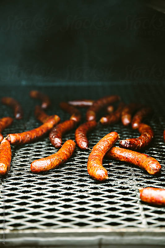 Sausage links on grill by Andrew Cebulka for Stocksy United