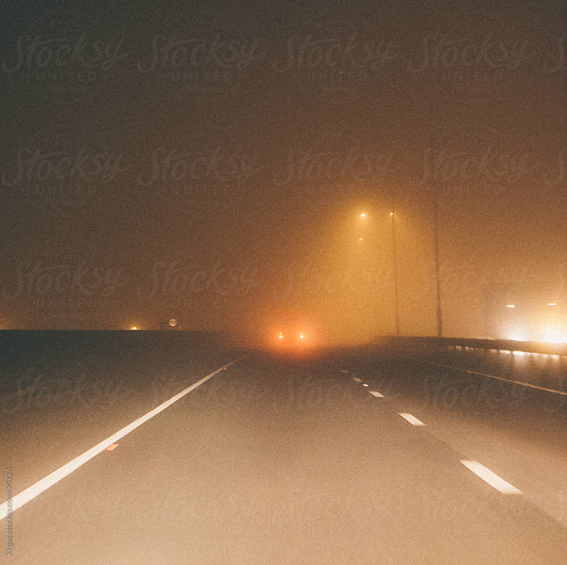 Hazardous driving in the fog by kkgas for Stocksy United
