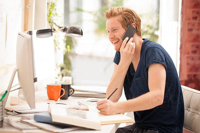 Man Telephoning While Studying by Lumina for Stocksy United