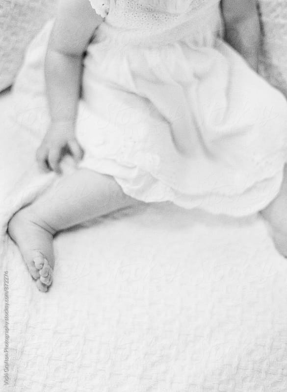 baby girl on couch  by Vicki Grafton Photography for Stocksy United