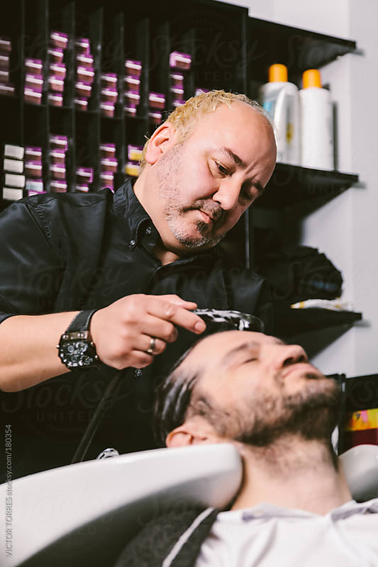 Barber Washing Hair to a Client by VICTOR TORRES for Stocksy United