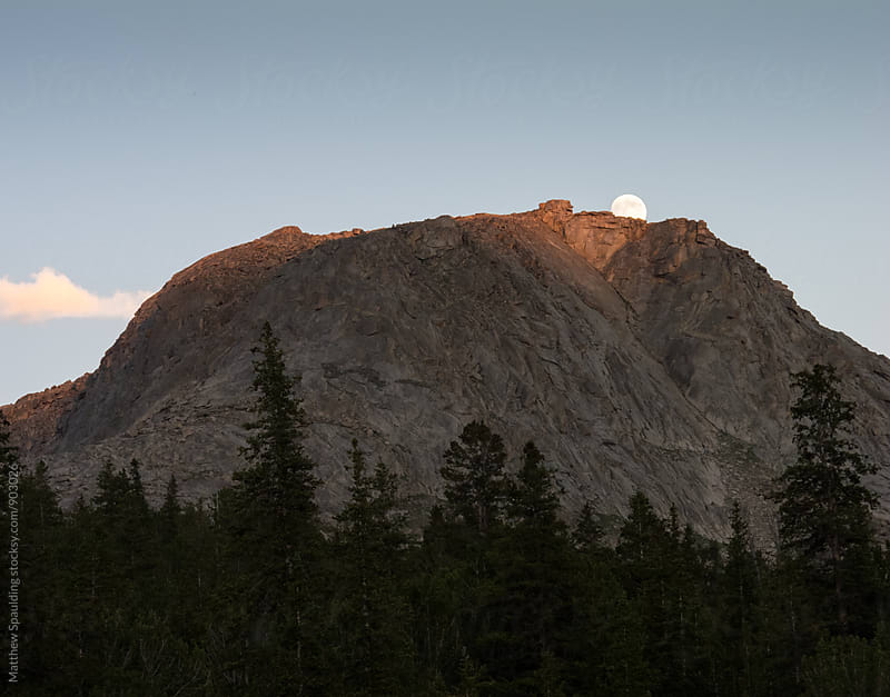 Moon rising over mountain in Wyoming by Matthew Spaulding for Stocksy United
