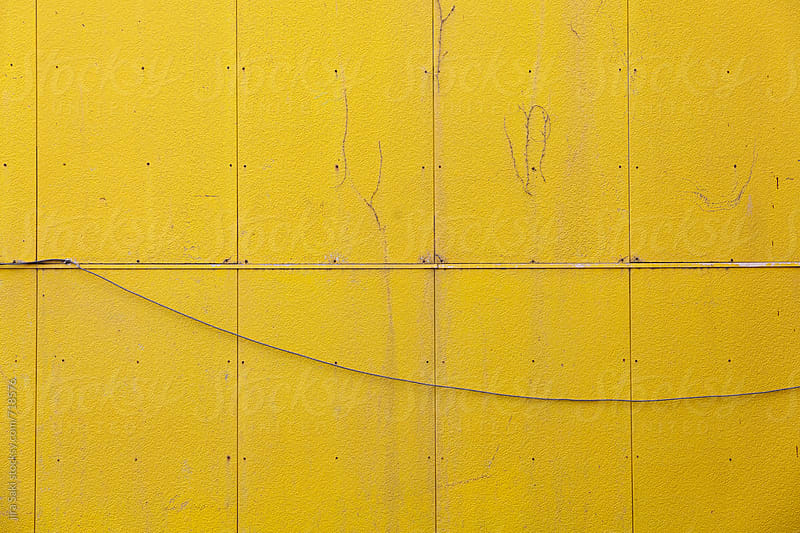yellow wall by jira Saki for Stocksy United