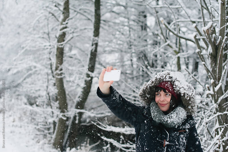 Selfie in the snow by Bruce and Rebecca Meissner for Stocksy United