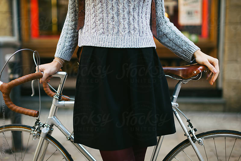 Closeup of a chic woman standing with her vintage bicycle on the street. by BONNINSTUDIO for Stocksy United