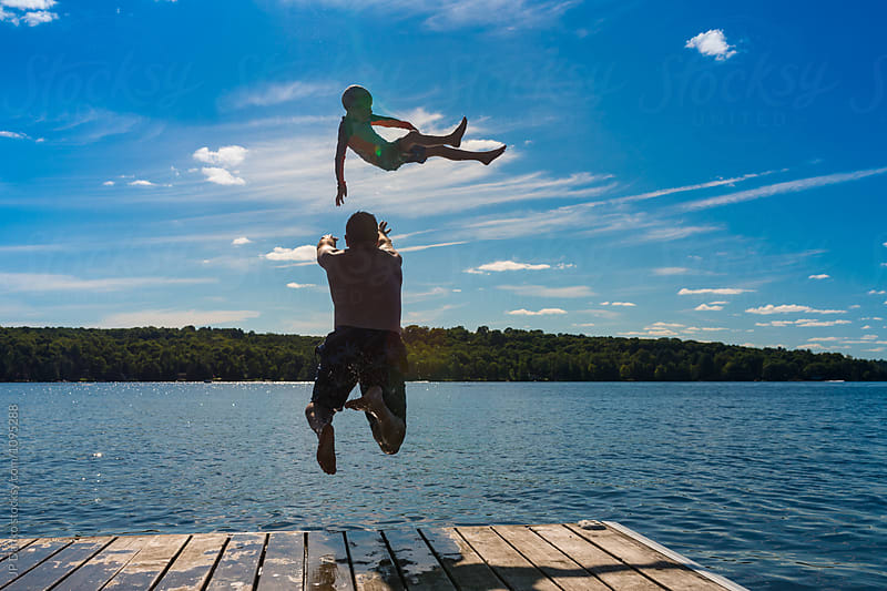 Man Throwing Boy Into Warm Summer Cottage Lake from Dock by JP Danko for Stocksy United