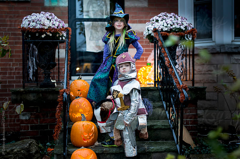 Children Dresses as Knight and Witch for Halloween Trick or Treat by JP Danko for Stocksy United