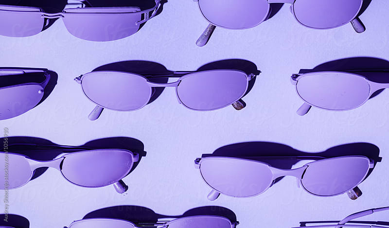 Purple/ violet sunglasses on purple/violet background. by Audrey Shtecinjo for Stocksy United