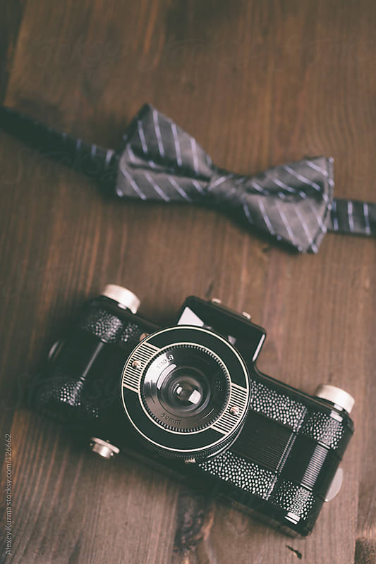camera and bow tie by Alexey Kuzma for Stocksy United