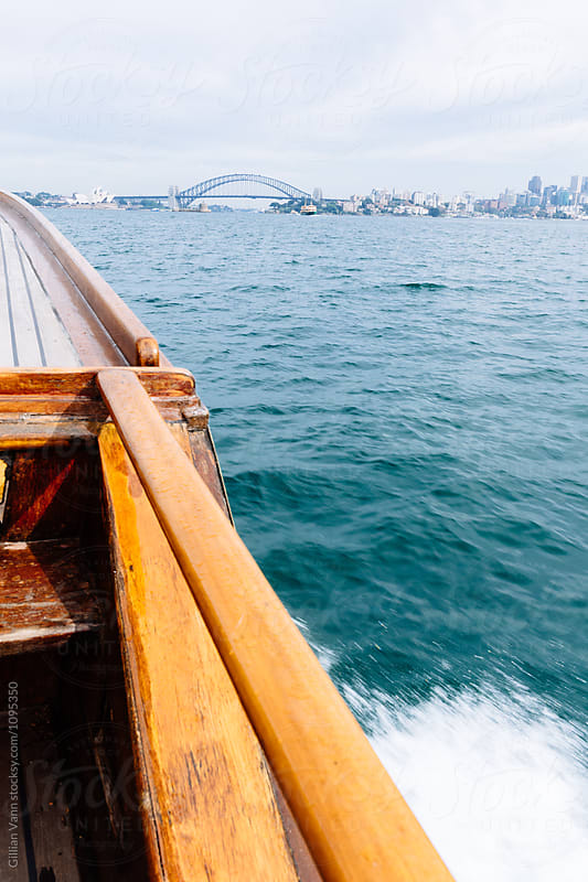 power boat making waves on Sydney Harbour by Gillian Vann for Stocksy United