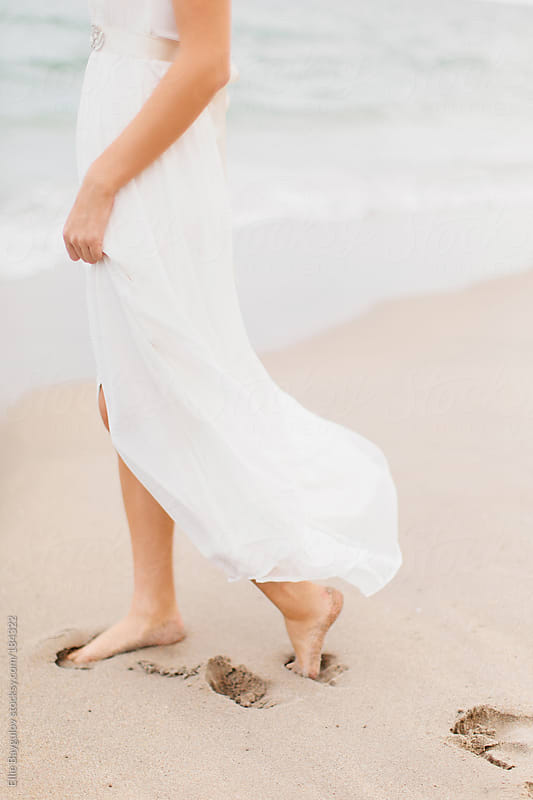 Bride on a beach by Ellie Baygulov for Stocksy United