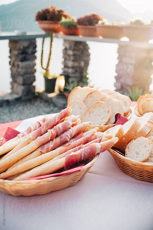 Prosciutto and grissini by Giada Canu for Stocksy United