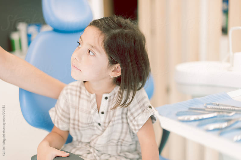 Little girl at dentist office by Guille Faingold for Stocksy United