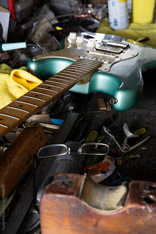 Guitar on work bench by Curtis Kim for Stocksy United
