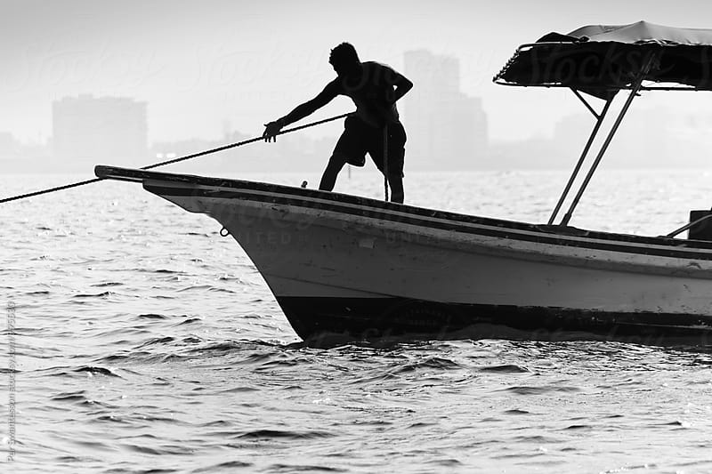 Silhouette of Mexican boatsman in Veracruz by Per Swantesson for Stocksy United