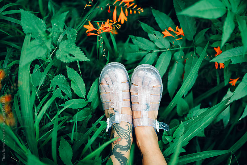 woman feet with leaves around by Thais Ramos Varela for Stocksy United