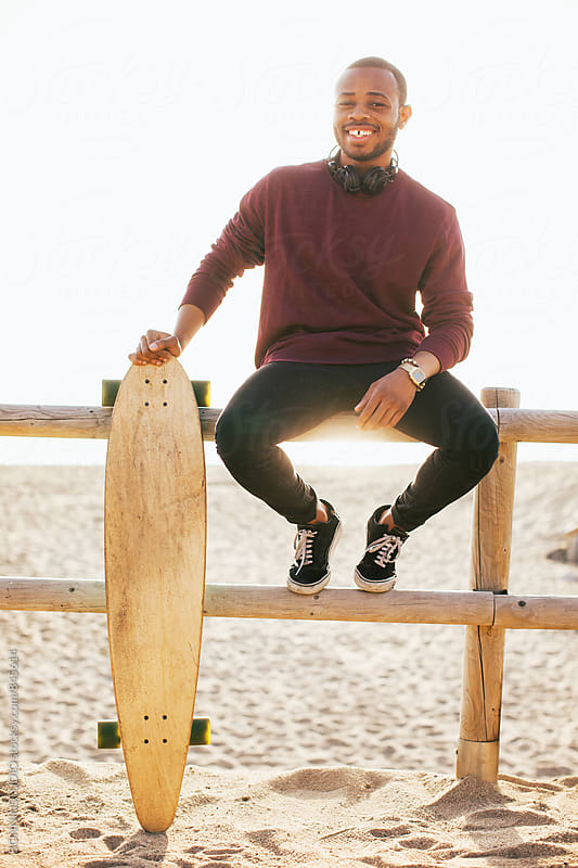 Young man with his longboard on the beach. by BONNINSTUDIO for Stocksy United