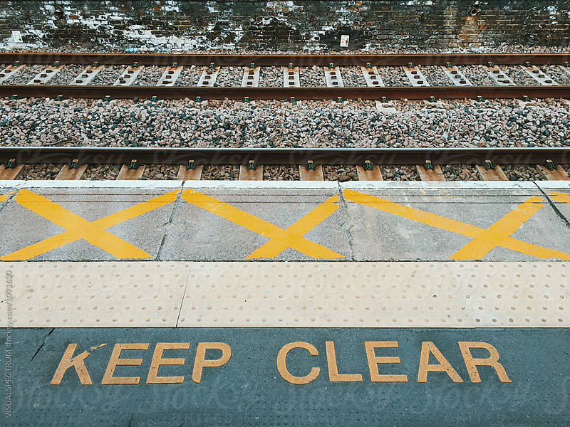 The Words Keep Clear at a London Overground Station by Julien L. Balmer for Stocksy United
