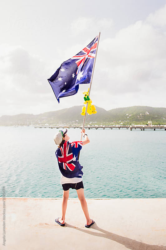 Boy waving an Australian flag by Angela Lumsden for Stocksy United