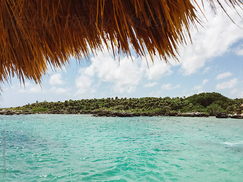 Caribbean landscape of blue ocean and lush island by Carey Shaw for Stocksy United