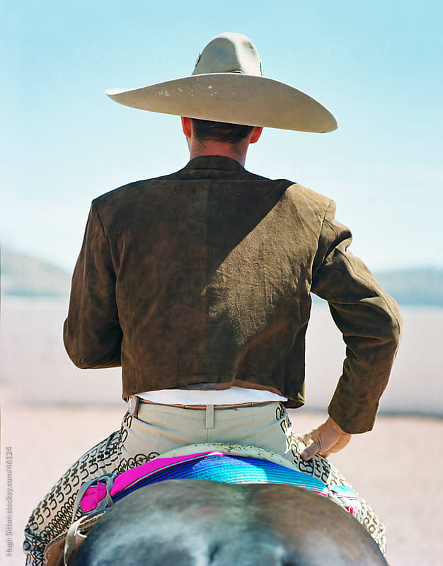 Mexican Cowboy with horse by Hugh Sitton for Stocksy United