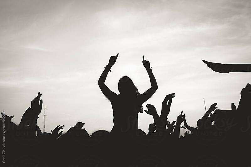 a woman celebrating in a festival crowd by Christian Zielecki for Stocksy United