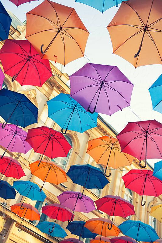 umbrellas in the sky by B & J for Stocksy United