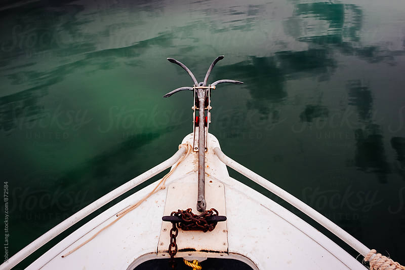 Bow of a small boat with anchor by Robert Lang for Stocksy United