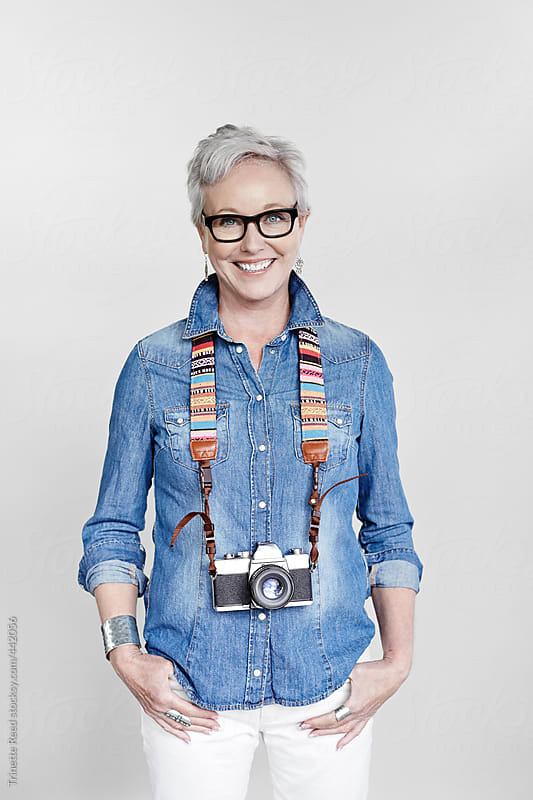 Portrait of stylish mature woman with vintage film camera by Trinette Reed for Stocksy United
