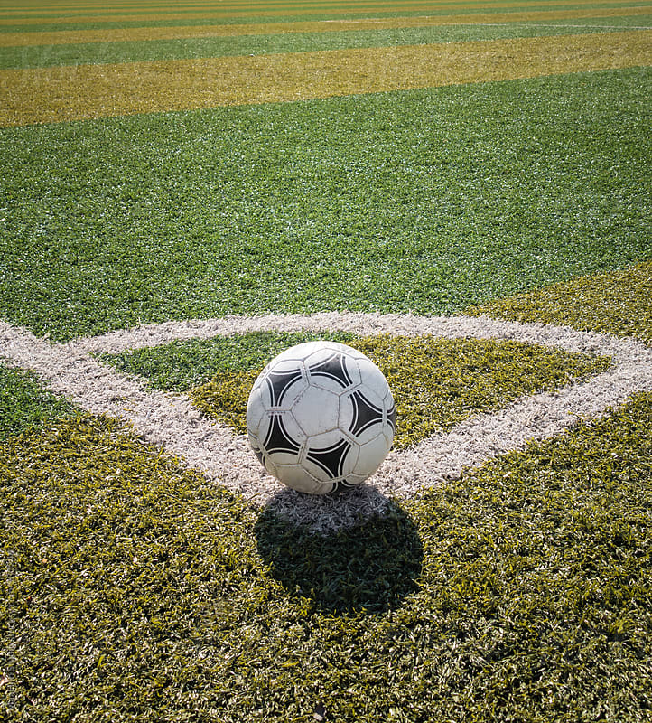 Football at the corner of football field by MaaHoo Studio for Stocksy United